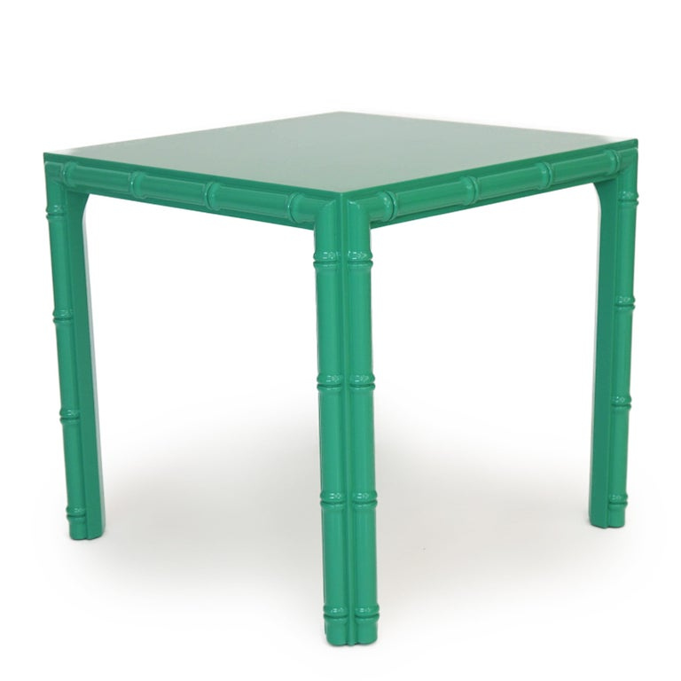 Antique midcentury faux bamboo side table newly lacquered in celadon green.   Measurements: 26.5