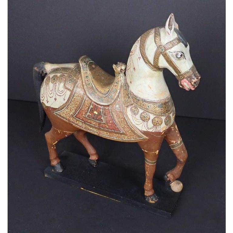 Antique Middle Eastern carved and paint decorated sculpture of a horse. Fine quality polychrome and gilt carved wood temple horse. The piece dates back to the late 19th century.