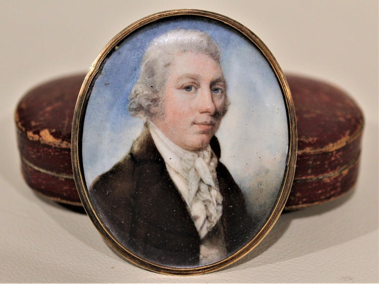 Dating from the late 17th century and done in the Federalist style, this finely detailed and well executed hand painted miniature portrait on bone of a period nobleman can be worn as a brooch, or displayed as a painting. The back is unmarked, but