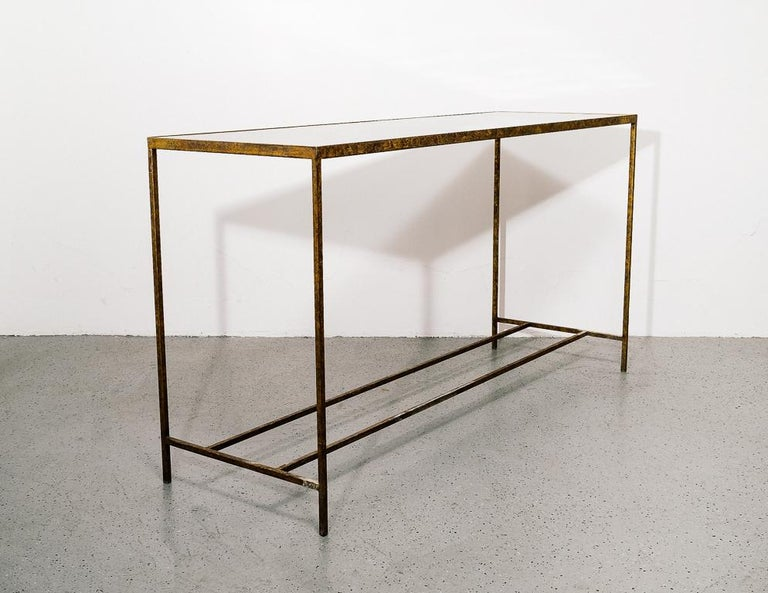 Modernist console or entryway table with gilded steel base and French polished tortoiseshell top.
