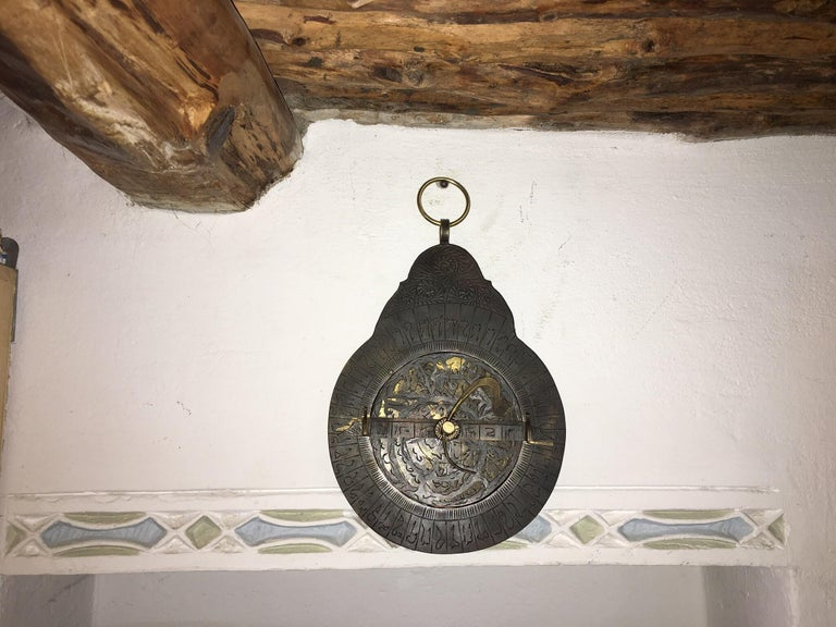 This handmade antique Moroccan compass was once used to cross the Sahara desert. It is made of copper. The rudimentary markings indicate different star constellations. Used by both Berber and Tuareg for desert travel.  This unusual compass was