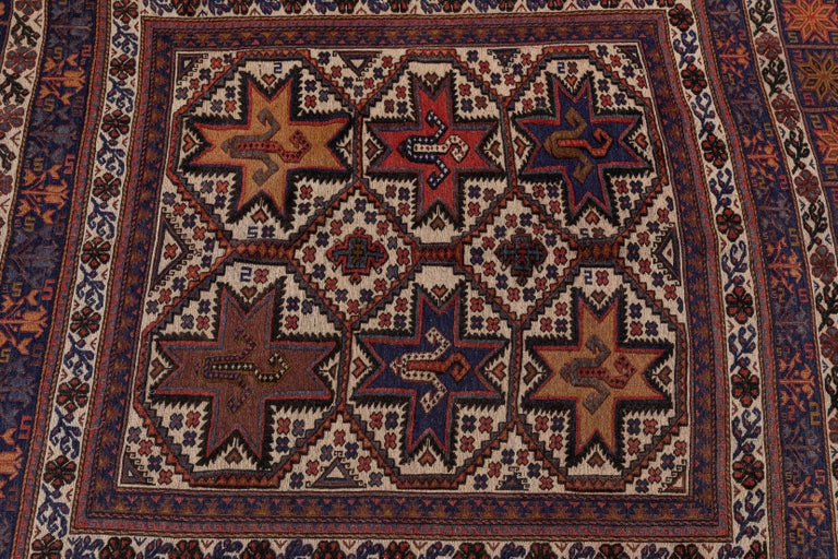 Antique Moroccan rug with floral motif, with reg, purple and orange accents.