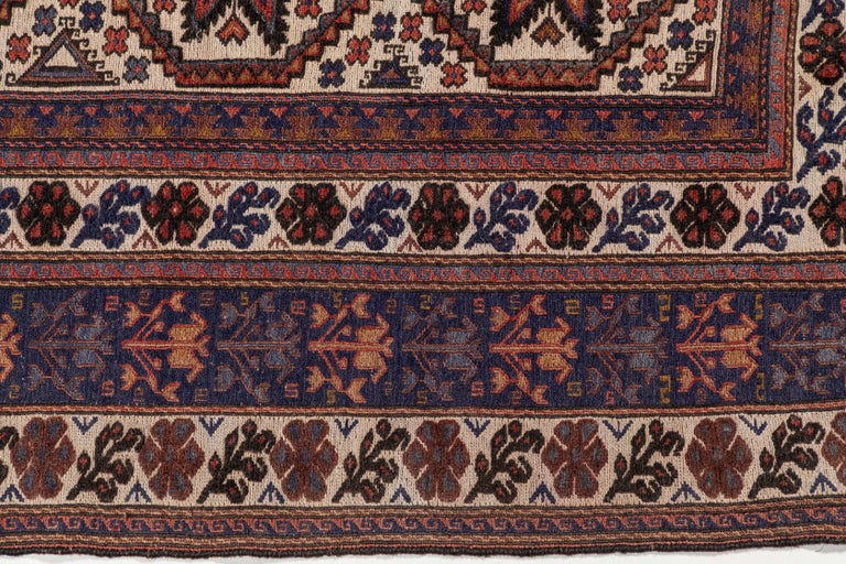 20th Century Antique Moroccan Rug with Floral Motif For Sale