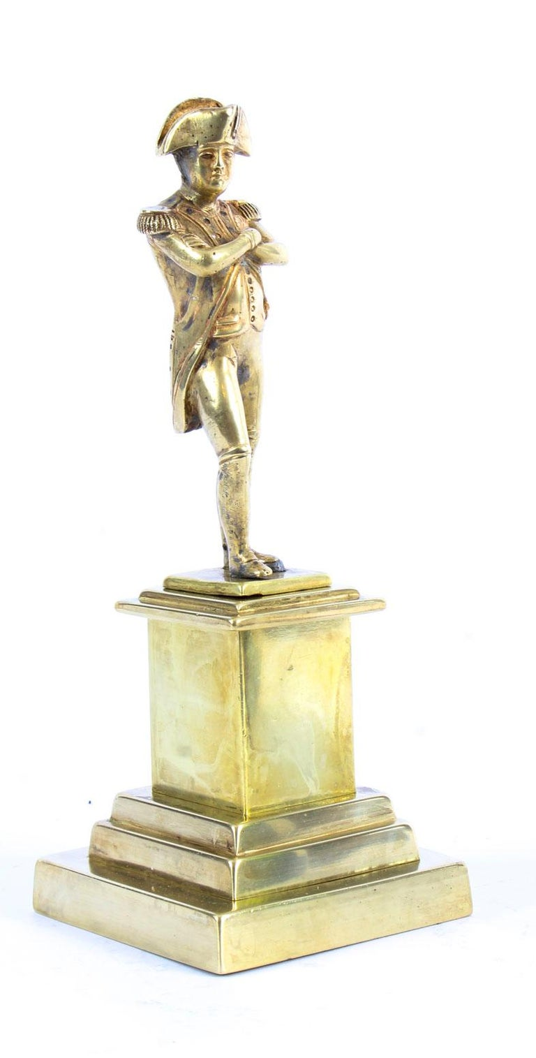 This is a highly collectable polished bronze desk model sculpture of the Emperor Napoleon Bonaparte, dating from the 19th Century.