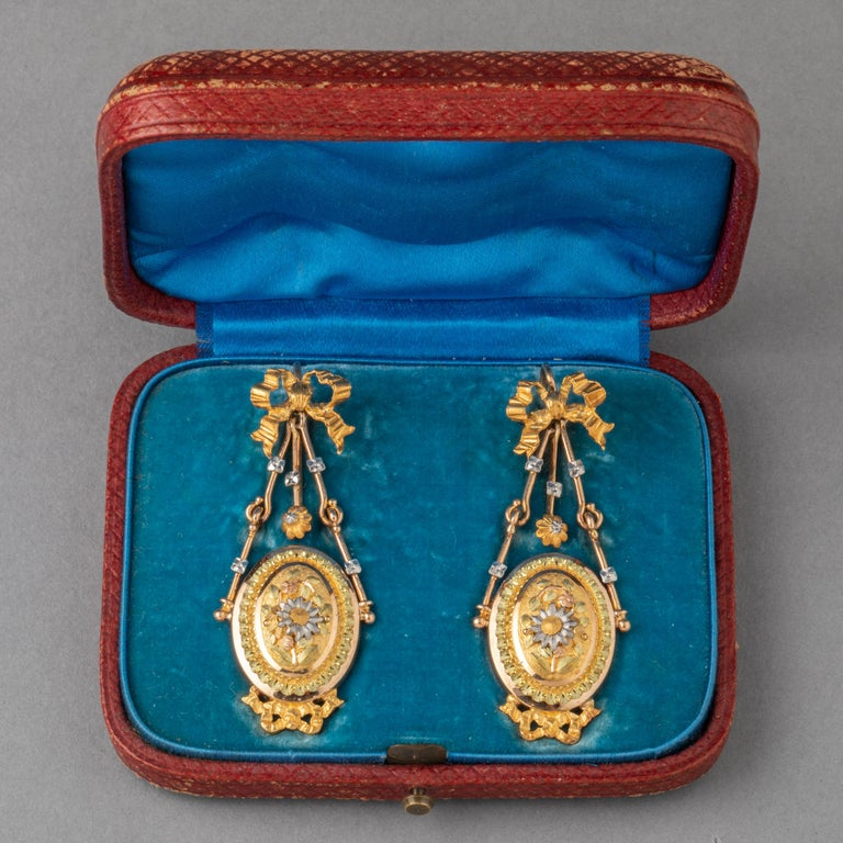 Very beautiful pair of antique Napoleon III earrings. Made in France circa 1860. Gold 18k, multiple color of gold. Little diamonds. Dimensions or earring: 5cm height ( 2inches) and 1.9 cm large. Total weight 12.4 grams.