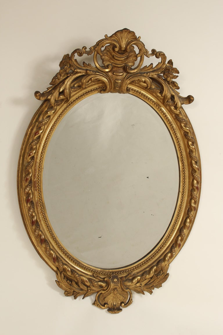 Antique Napoleon III style giltwood and composition mirror, late 19th century. With gold leaf finish and beveled glass.
