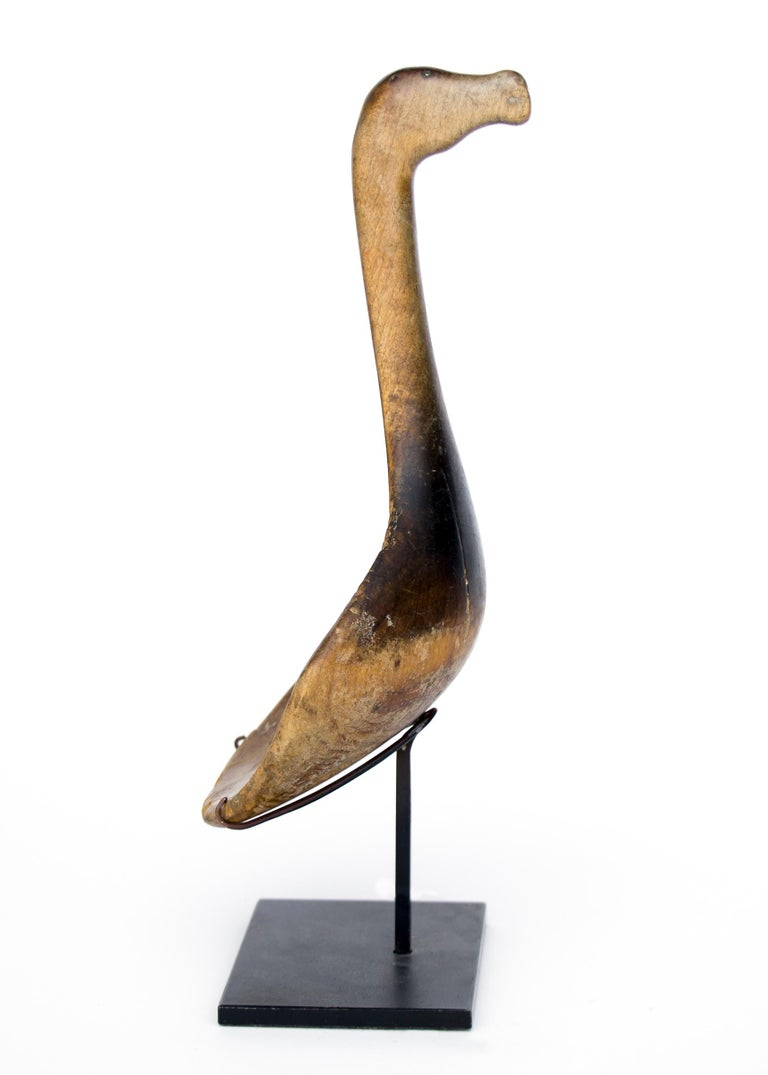 A rare antique Classic Period (pre-reservation era) Native American carved wood horse effigy spoon, Mesquakie (Great Lakes region). Carved from a single piece of hardwood, the handle depicts a horse head with eyes made from very small pieces of