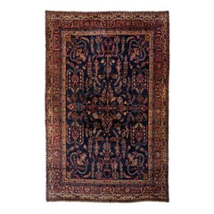 Antique Navy Blue and Gold Floral Persian Kirman Rug, circa 1920s-1930s