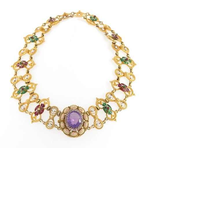 An English Antique 15 karat gold necklace with amethyst, diamond and natural pearl. The necklace has an oval cut amethyst approximately 9.50 carats, 30 old mine-cut diamonds with an approximate total weight of .30 carats, and 24 natural pearls