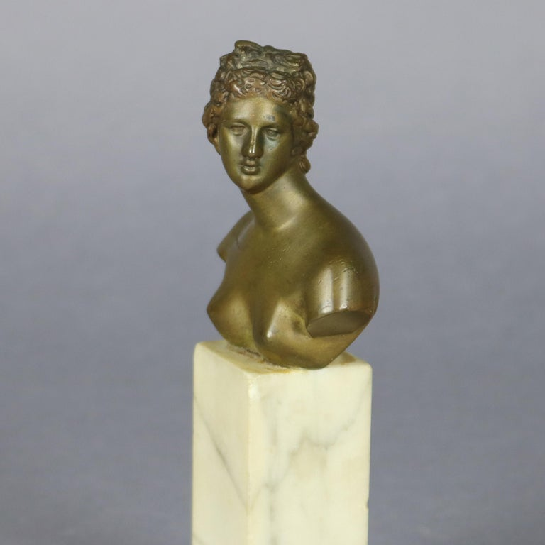 Antique neoclassical portrait sculpture of Greek Goddess Artemis features bronze bust raised on square marble plinth, circa 1890