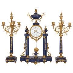 Antique Neoclassical Style Lapis Lazuli and Gilt Bronze Clock Set