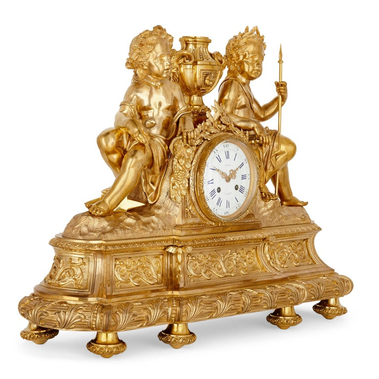 Antique neoclassical style three-piece gilt bronze clock set