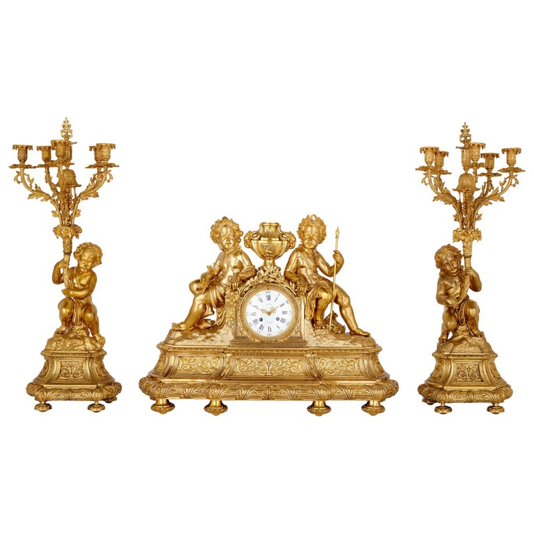 Antique Neoclassical Style Three-Piece Gilt Bronze Clock Set For Sale