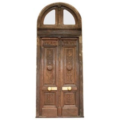 Antique Oak Tall Exterior Carved Doors with Arched Transom and Frame
