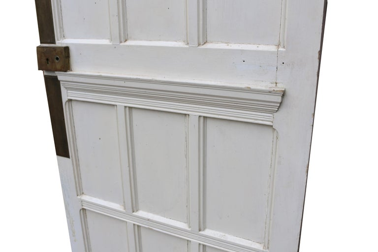 About  This door is faced in oak to the front, with the reverse made from pine, with a painted finish.   Condition report:  In good condition for its age. There are no hinges present. There is a brass lock, untested.