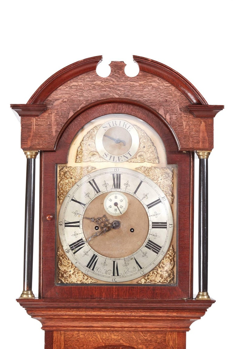 Antique oak brass face 8 day grandfather clock, with a swan-neck pediment lovely brass face with seconds dial, strike and silent dial, 8 day duration mechanism striking the hour on a bell, lovely oak case standing on shaped bracket feet, in working