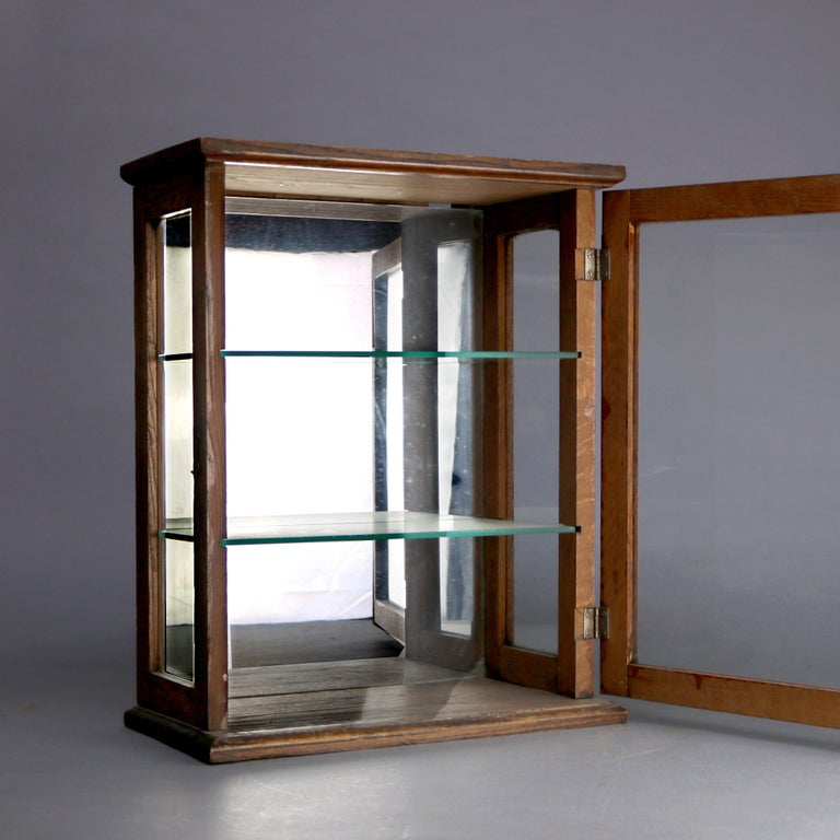 Carved Antique Oak Country Store Mirrored Display Cabinet, circa 1900 For Sale
