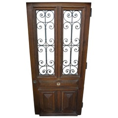 Antique Oak Door with Ornate Iron Work and Centre Knob, circa 1870