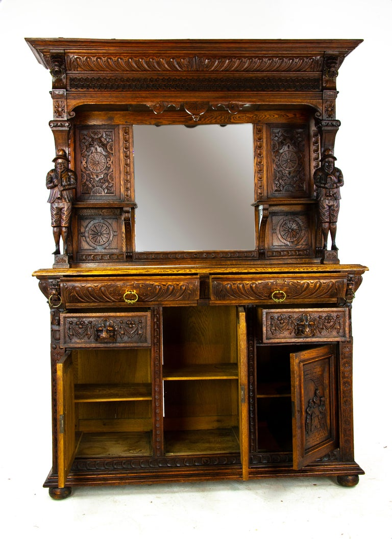 Antique oak sideboard, carved oak sideboard, Anglo-Flemish, antique furniture, Scotland, 1880, b1498  Scotland 1880 Solid oak construction with original finish Has a projecting carved moulded cornice over central mirror Flanked by carved panels