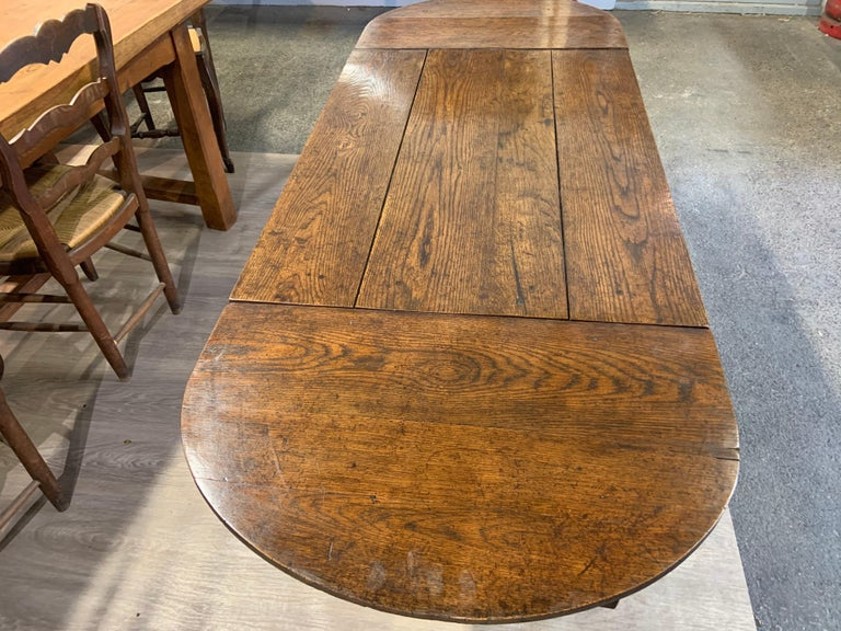 Antique trestle table with two half moon leaves. This table has a lot of character and sits on the most beautiful base. So versatile with the two leaves. Table length without leaves 38.5