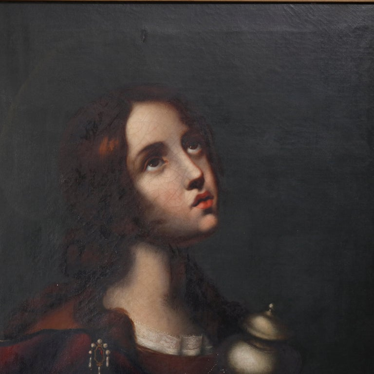 An antique oil on canvas old master painting depicts Mary Magdalene seated in giltwood frame, 19th century  Measures: 36.75