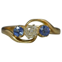 Antique Old Cut Diamond and Ceylon Sapphire 18 Carat Gold Trilogy Ring