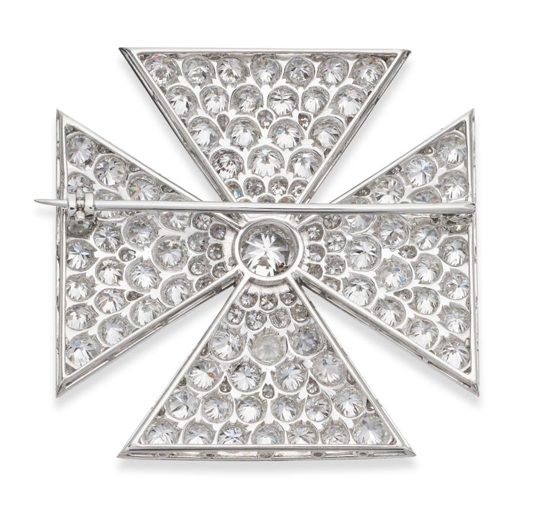 Exceptional diamond Maltese cross brooch, set in platinum. Old European cut diamonds dazzle from every angle in this brooch.  1 x Center diamond, approximate weight 1.20 carats The rest diamonds approximate weight 11.0 carats, assessed colour H/I,