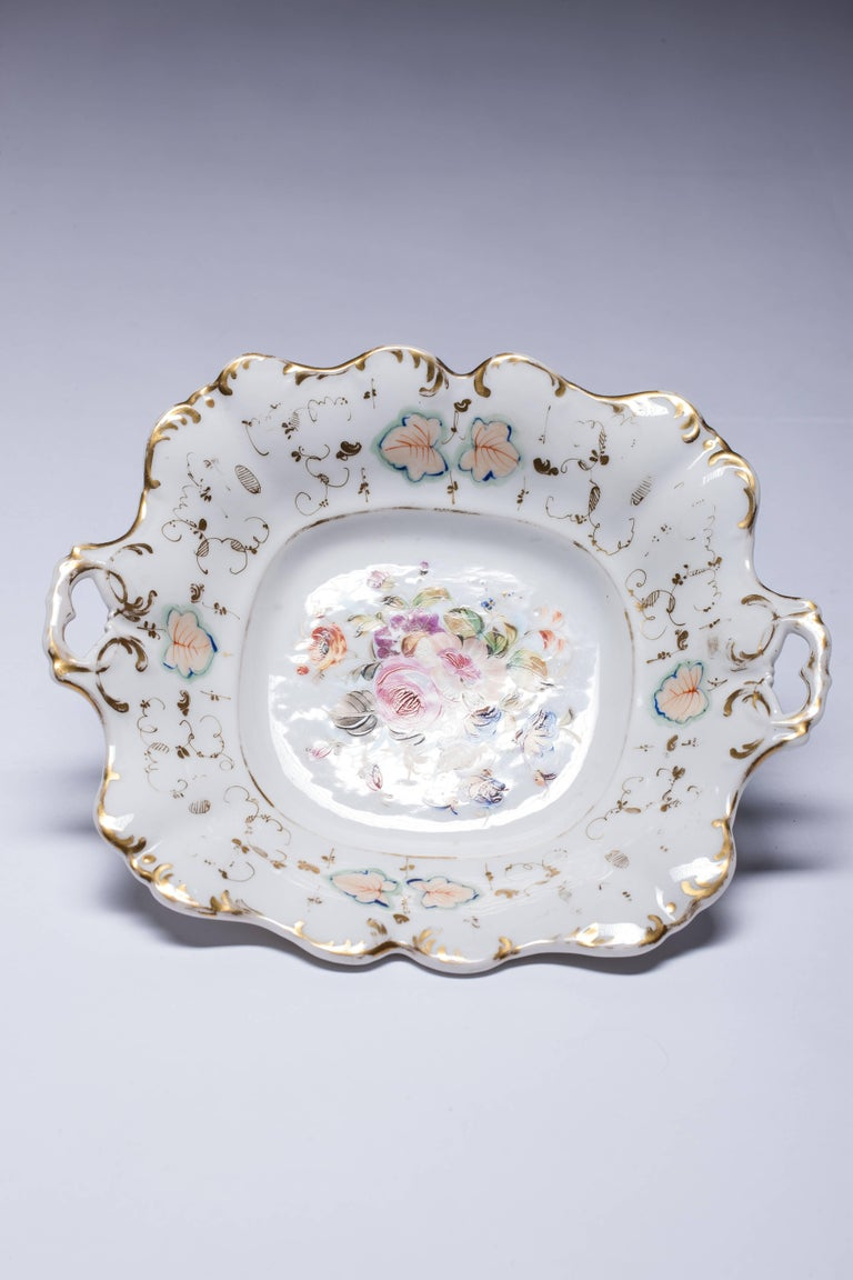 This set of four porcelain plates are hand-painted, featuring bouquets of flowers. They date from the period 1850-1880 in Old Paris or Vieux Paris style. Price for both items.