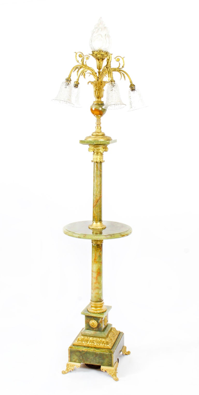 This is a truly superb antique onyx and ormolu Louis XVI Revival floor standard lamp, circa 1900 in date.   This exceptional lamp features a stunning flaming torch at the top surrounded by five further exquisite branches with beautiful cut glass