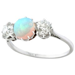 Antique Opal and 1.08 Carat Diamond Gold Trilogy Ring, circa 1920