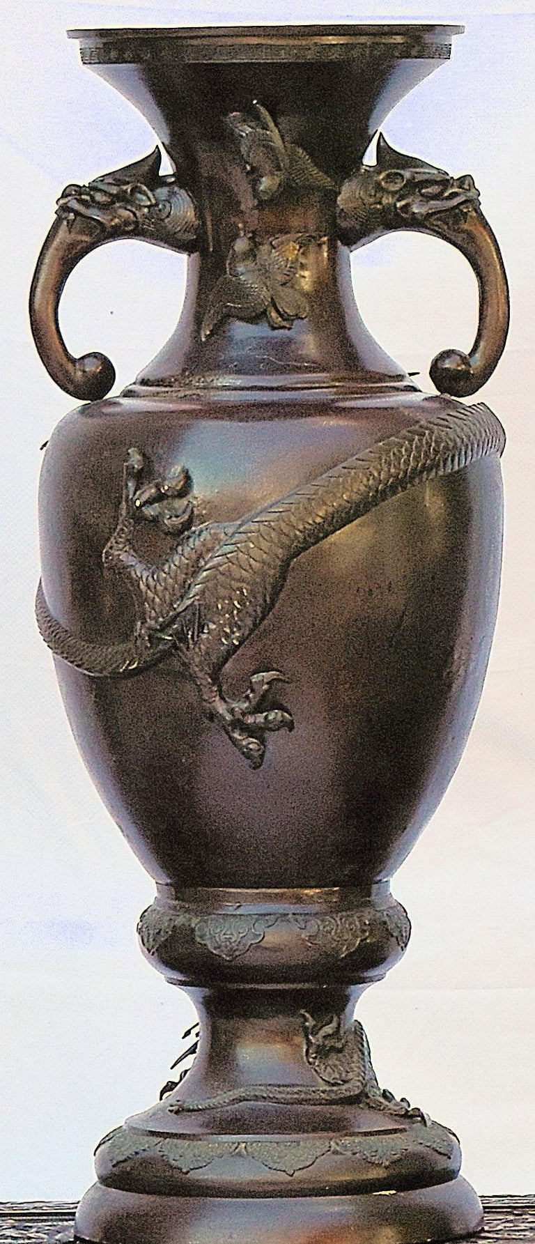 Chinese bronze altar vase decorated in the Archaistic style with mythical beast loop handles and a large dragon wrapping around the front of the vase.  bkx1