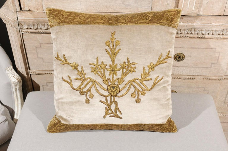 A pair of antique ottoman Empire raised gold metallic embroidery on silver velvet Bohça, made into down-filled pillows. Taken from a distressed Bohça (deriving from the Arabic word for package, a Bohça is a large square piece of cloth used to wrap