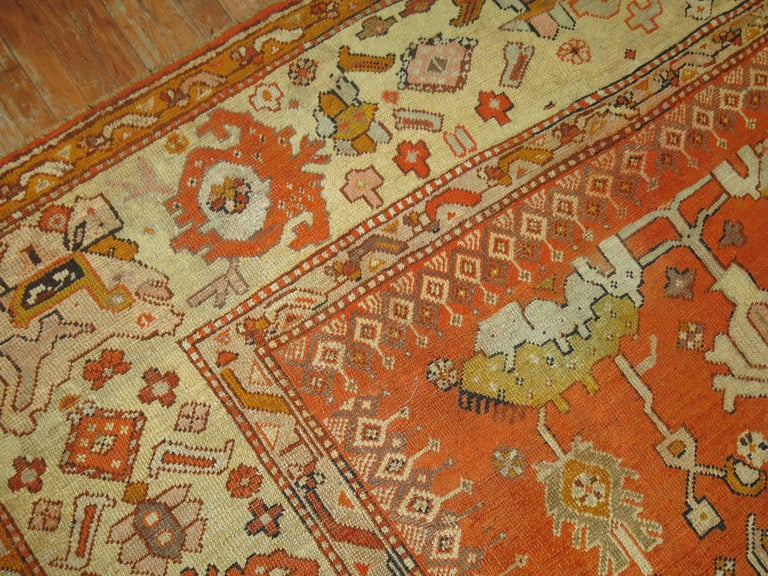 An exhilarating late 19th century antique Turkish Oushak rug in predominant bright orange accents. The finest quality of wool that you can find in any type of rug from this origin.