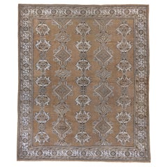 Antique Oushak Rug, Brown Field, Light Blue Borders and Motifs