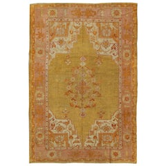 Antique Oushak Rug in Yellow Green Background, Pink Border, Red & Orange Accents