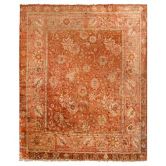 Antique Oushak Salmon and Copper Geometric-Floral Wool Rug