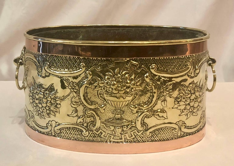 Antique oval brass and copper jardinière, circa 1900.
