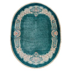 Antique Oval Chinese Rug in Turquoise with Coral and Violet Flower Blossoms