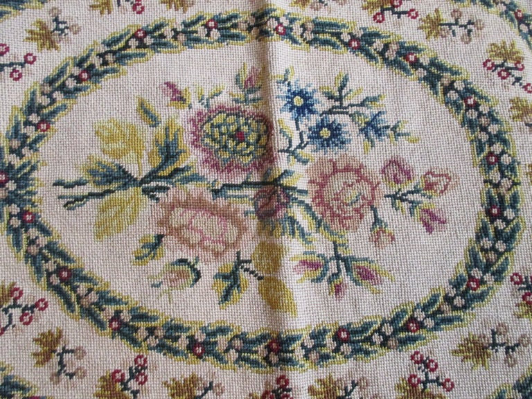 Antique oval seat cover with roses at the center In shades of yellow, red and blue Numbered: 35104/16205 Size: 17