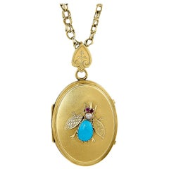 Antique Oval Locket Bee Design Comprised of Turquoise, Ruby and Pearl in 14kt