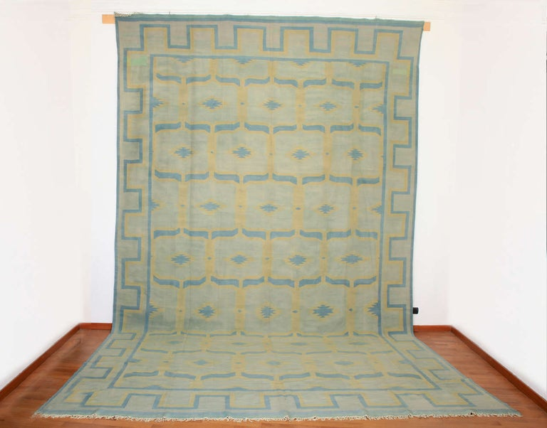 Dhurries of such large formats were almost exclusively woven on specific commissions to decorate the palaces of the Maharajahs of northern India. This monumental example is distinguished by a large scale all-over pattern in soft, pastel shades.