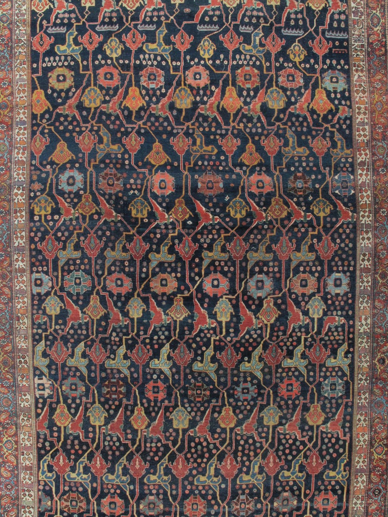 Antique Persian Bidjar rug, circa 1880. A wonderful antique Bidjar rug with a navy blue filed filled with detailed floral designs and surrounded by multiple borders, a true masterpiece of the weavers skill. The best antique Persian carpets from