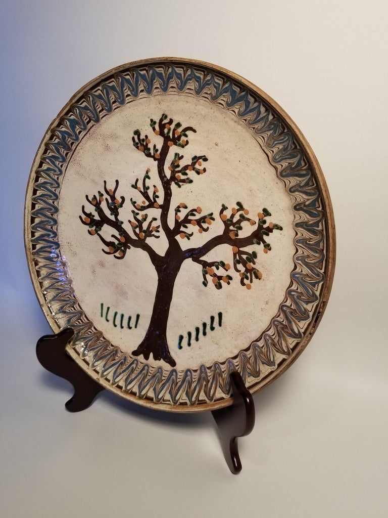 Charming folk art plate with a painted tree, American, early 20th century.
