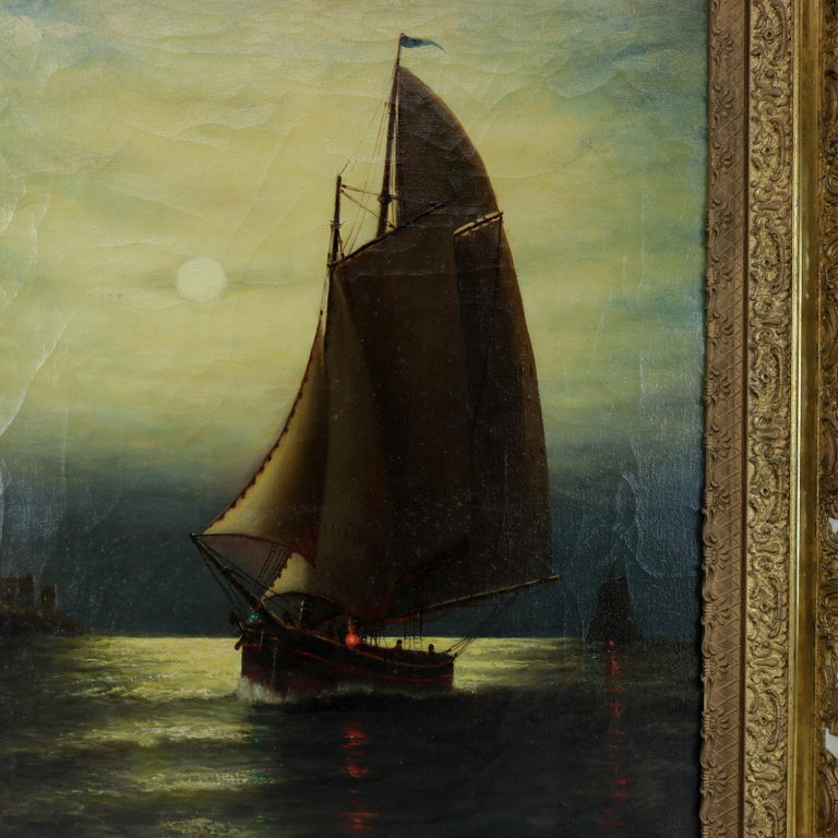 Antique maritime oil on canvas painting depicts moonlit nautical seascape scene with sailboat signed Wesley Webber, seated in giltwood frame, circa 1900.  Measures: 31.25