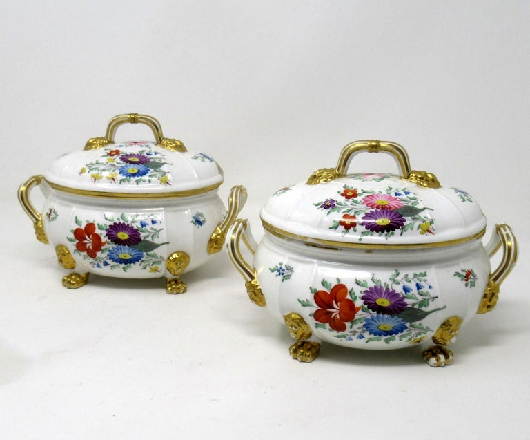 Very elegant pair of early English Regency Royal Crown Derby Twin Scroll Handle Oval Outlined Food Tureens of compact proportions. First quarter of the 19th century.   Lavishly gilded and hand decorated with various Summer Flowers on an off-white