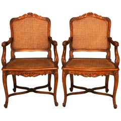 Antique Pair of French Louis XIV Pressed Walnut and Cane Chairs, circa 1920