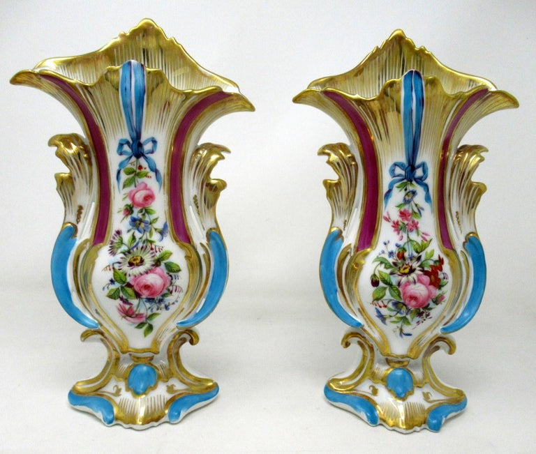 A very elegant pair of hand decorated Vieux Paris porcelain vases of generous proportions, outstanding quality and good untouched condition, last half of the 19th century.  Of ovoid form with Rococo elements and shaped and pointed upper rims, the