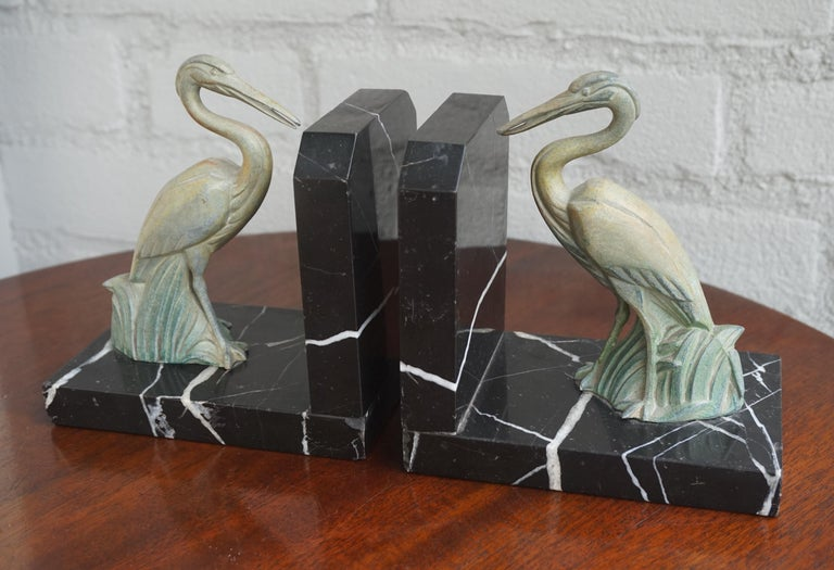 Beautiful and rare pair of sculptural Art Deco bookends.  These small size black and white marble bookends come with a pair of beautifully sculptured, standing storks in the reeds. They are much like the green Art Deco sculptures that Max Le Verrier