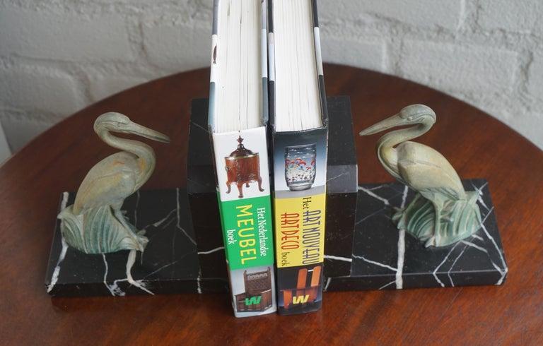 Cast Antique Pair of Art Deco Bookends with Max Le Verrier Style Stork Sculptures For Sale