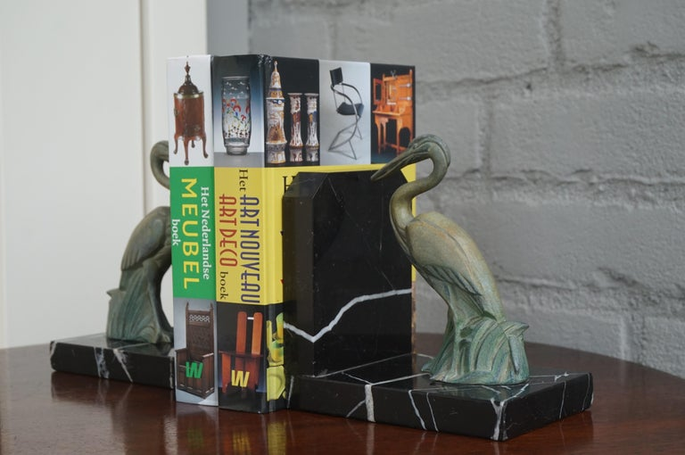 Spelter Antique Pair of Art Deco Bookends with Max Le Verrier Style Stork Sculptures For Sale